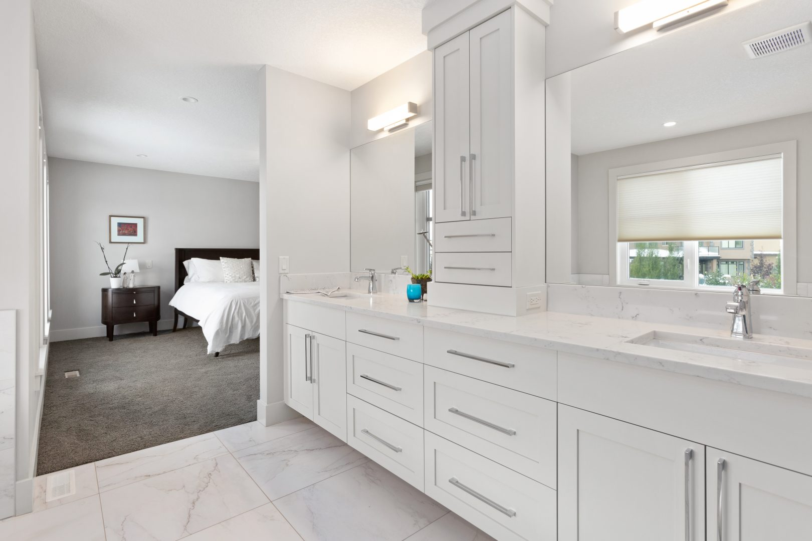 Real Estate Photography. A master's bedroom ensuite bathroom with double sink for he and him photographed by Ryan Haggel from Calgary Real Estate Photography for a real estate agent based in Calgary Alberta.