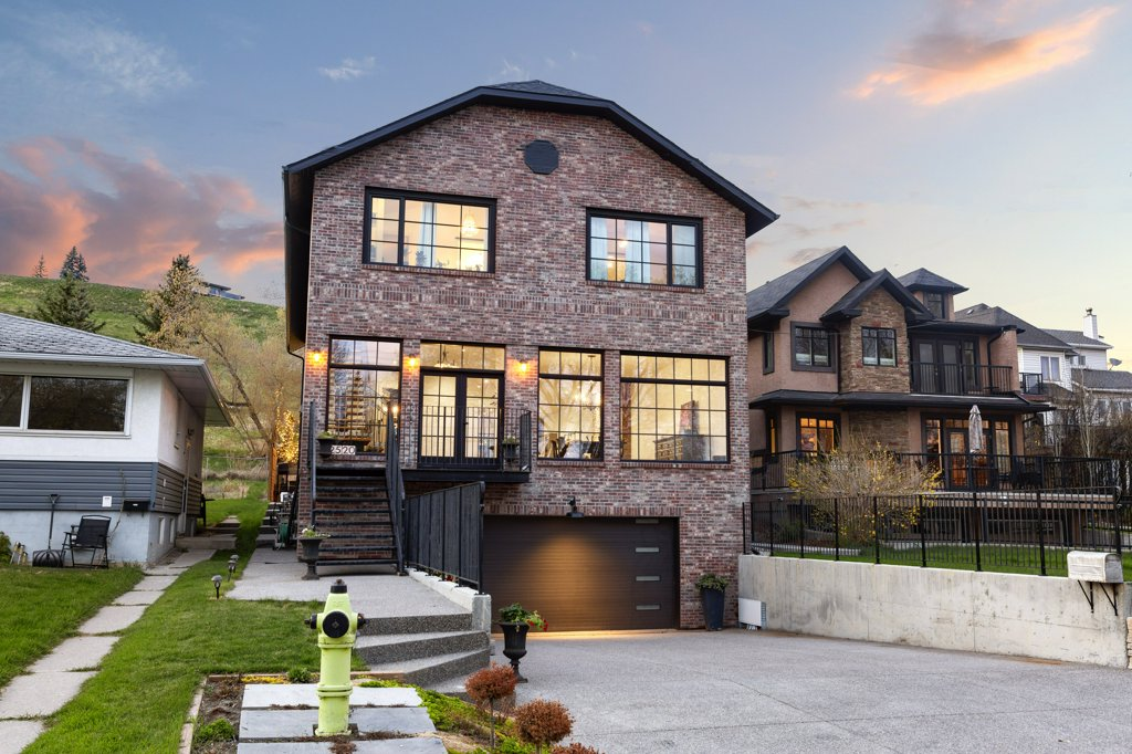 Real Estate Photography. A premium exterior photo of a luxury three storey home photographed by Ryan Haggel from Calgary Premium Real Estate Photography.