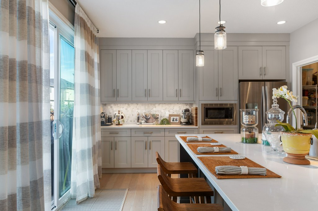 Real Estate Photography. A premium interior photo of a kitchen photographed by Ryan Haggel from Calgary Premium Real Estate Photography.