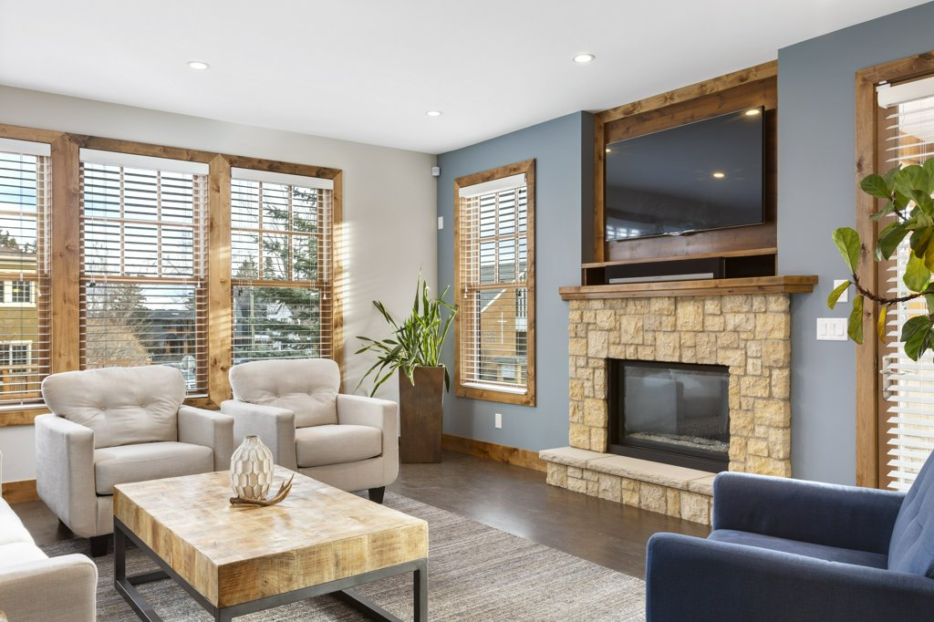 Real Estate Photography. A premium interior photo of a living room photographed by Ryan Haggel from Calgary Premium Real Estate Photography.