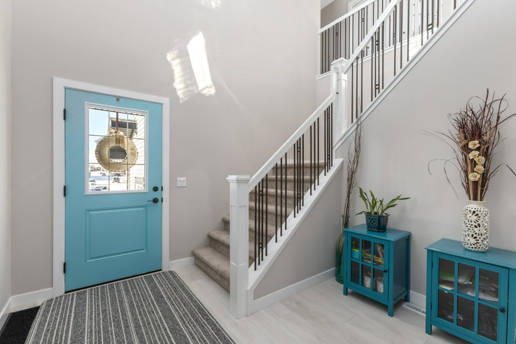 Real Estate Photography. A premium interior photo of a mudroom photographed by Ryan Haggel from Calgary Premium Real Estate Photography.