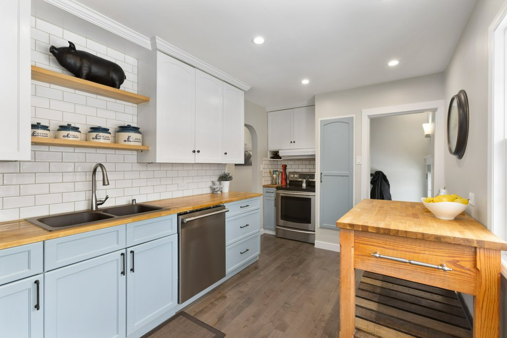 Real Estate Photography. A premium interior photo of a minimalist kitchen photographed by Ryan Haggel from Calgary Premium Real Estate Photography.