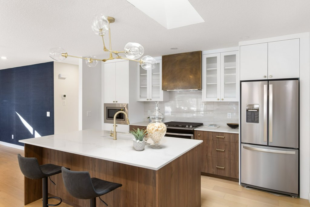 Real Estate Photography. A premium interior photo of a high-end kitchen photographed by Ryan Haggel from Calgary Premium Real Estate Photography.