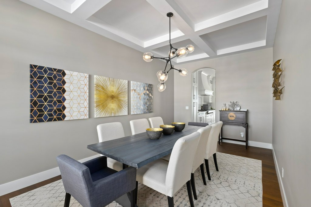Real Estate Photography. A premium interior photo of a dining hall photographed by Ryan Haggel from Calgary Premium Real Estate Photography.